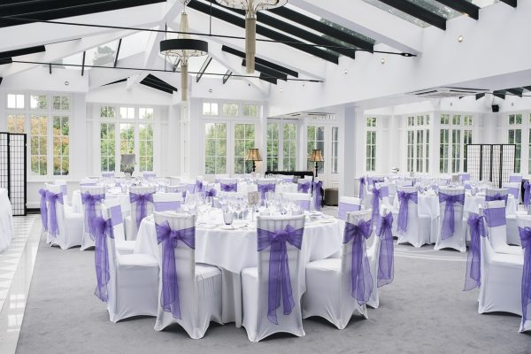 Cambridgeshire weddings purple bow backed chairs in dining room