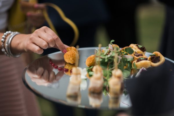Mini food canapes guests helping themselves at Cambridgeshire wedding