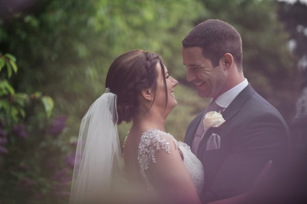 Bride and groom just married smiling at Cambridgeshire wedding
