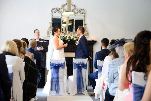 Bride and groom getting married at Swynford Manor