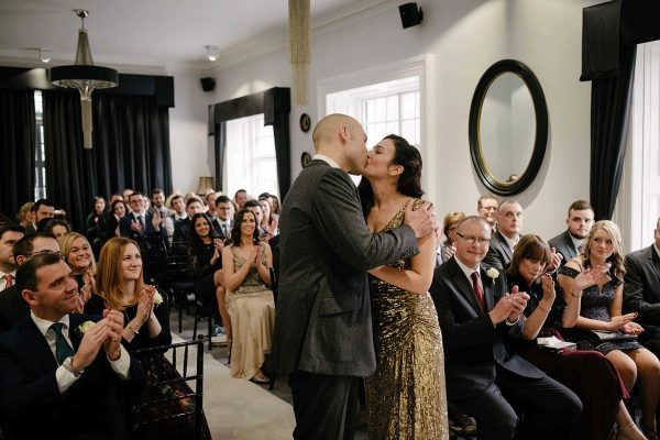 Bride and grooms first kiss at wedding venues Newmarket