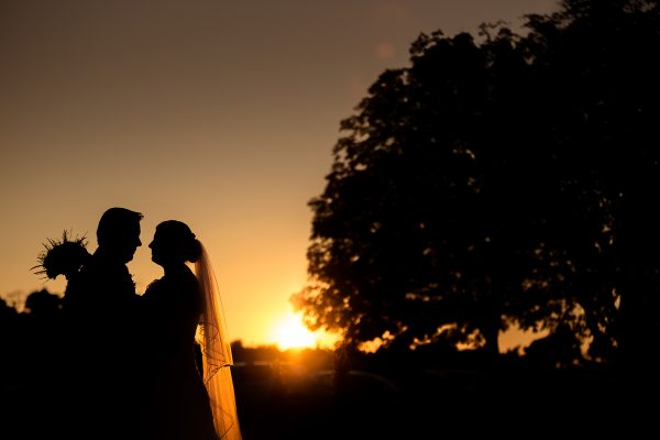 Bride and groom with sunset in background Cambridgeshire weddings