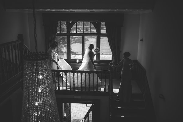 Cambridgeshire weddings black & white bride descending the stairs