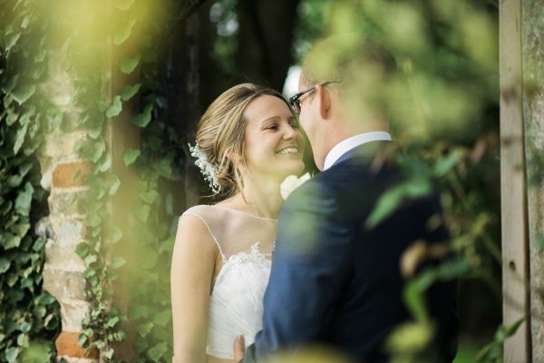 Cambridgeshire wedding bride and groom smiling in the gardens