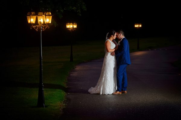 Bride and groom in the outdoor wedding space at Swynford Manor
