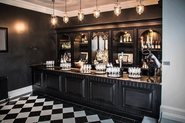 Bar at manor house black and white checkerboard floor Cambridgeshire weddings