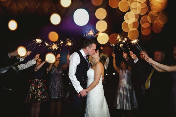 Bride and groom celebrating on their wedding day at swynford manor