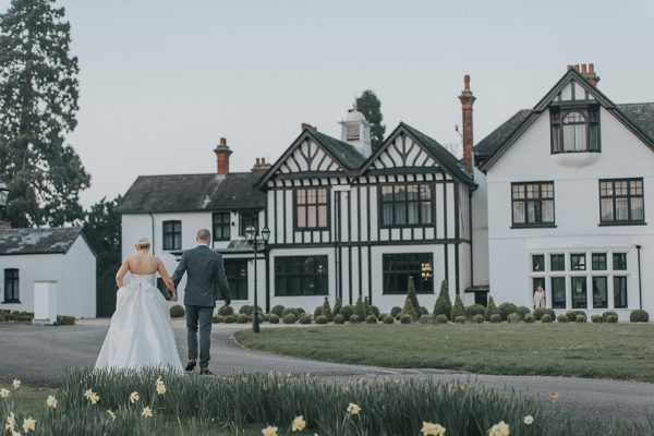 Stroll hand in hand around the gardens of this beautiful manor house wedding venue in Cambrideshire - spring wedding