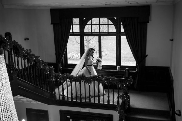Decorate the staircase at Swynford Manor with a festive garland for a beautiful Christmas wedding