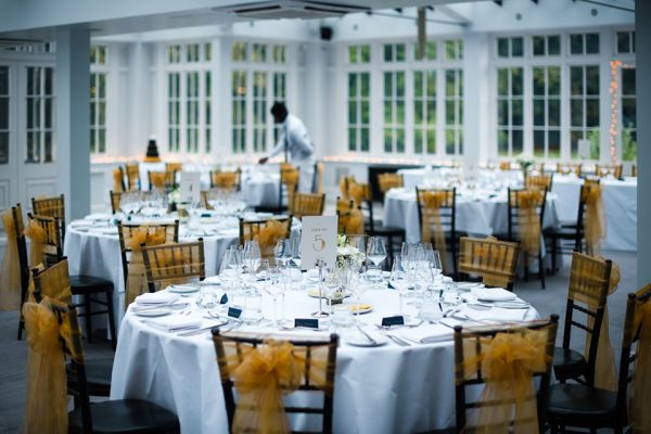 Wedding decorations and yellow ribbon look beautiful for your autumn themed wedding at Swynford Manor