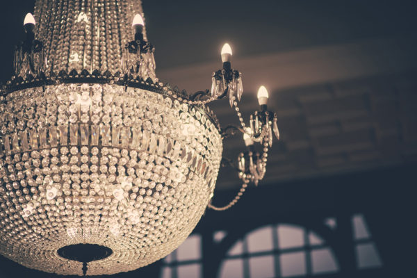 A giant crystal chandelier at Swynford Manor wedding venue is a magnificent focal point for your wedding photographs
