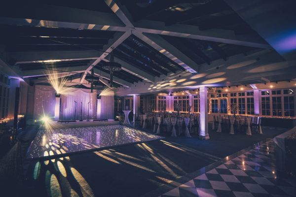 A dancefloor is set up in the Garden Room at Swynford Manor ready for an evening wedding reception