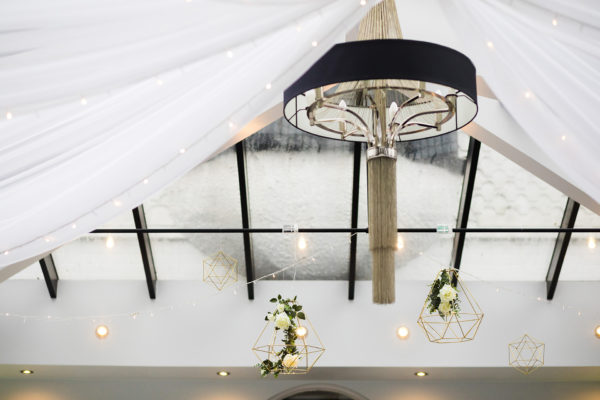 A couple chose to hang drapes from the ceiling in the Garden Room at Swynford Manor