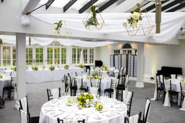 The Garden Room at Swynford Manor is set up for a modern wedding breakfast