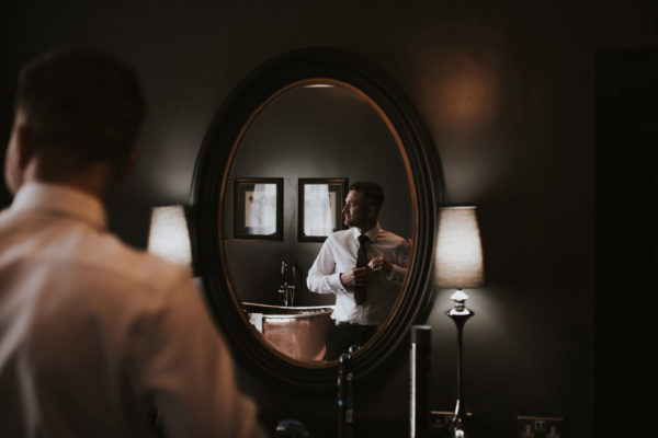 The groom prepares for his wedding ceremony at Swynford Manor wedding venue in Cambridgeshire