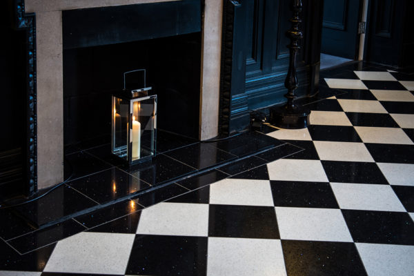 A lantern casts light on to the stunning checked floor at this Cambridgeshire wedding venue