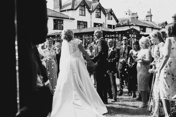 Wedding confetti is thrown over the newlyweds after their wedding ceremony at Swynford Manor