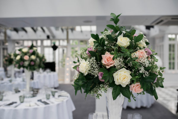 Pink and cream roses were used as table centrepieces for a wedding breakfast at Swynford Manor