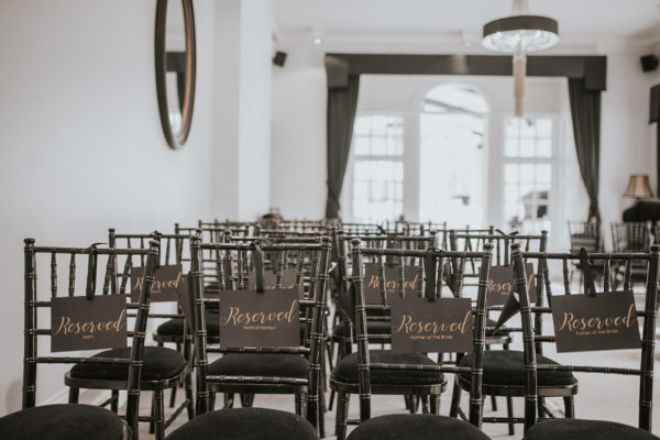 Seats are reserved for a wedding ceremony in the Study at Swynford Manor