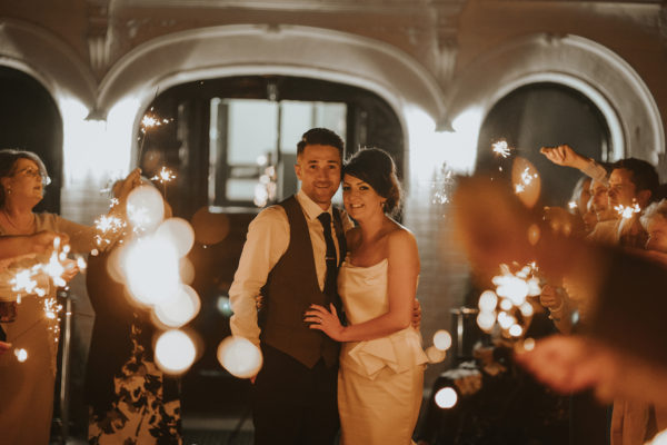 The newlywed couple have a stunning sparkler exit at the end of their wedding day at Swynford Manor