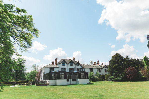Swynford Manor wedding venue in Cambridgeshire boasts grand gardens which are perfect for wedding photographs