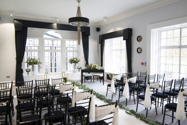 The Study at Swynford Manor wedding venue in Cambridgeshire is set up for a classic wedding ceremony