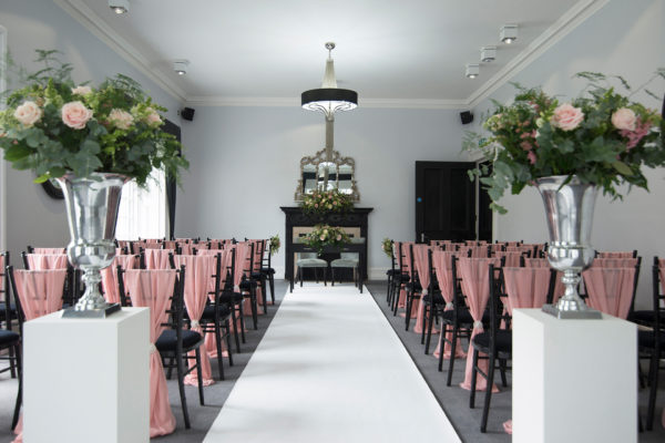 The Study at Swynford Manor is set up for a pink and silver wedding ceremony