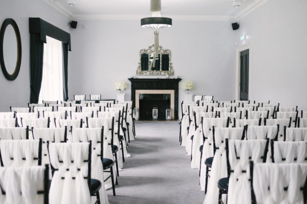 The Study at Swynford Manor is set up for a stylish white wedding ceremony