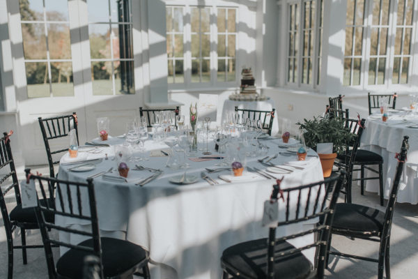 A table in the Garden Room at Swynford Manor is set up for an elegant wedding breakfast