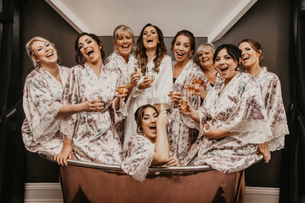 During their wedding preparations at Swynford Manor the bride and her bridesmaids have fun in the statement copper bath