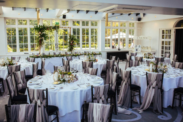 The Garden Room at Swynford Manor is dressed for a modern wedding reception