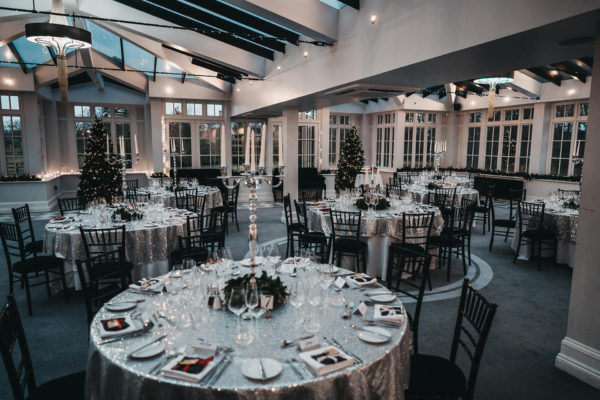 The Garden Room at Swynford Manor is dressed for a winter wedding reception