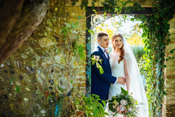 Newlyweds explore the gardens at Swynford Manor on their wedding day