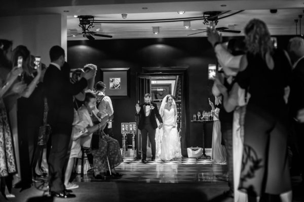The newlyweds make a grand entrance into their evening reception at Swynford Manor