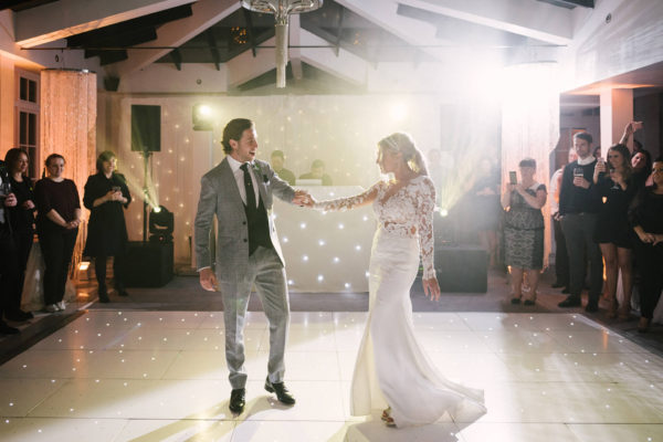 Newlyweds perform their first dance in front of guests at Swynford Manor