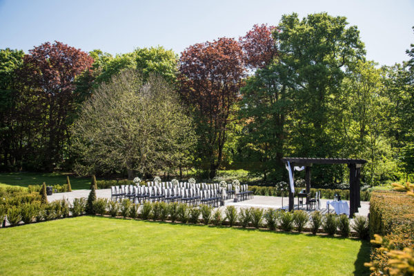 The gardens at Swynford Manor wedding venue in Cambridgeshire are set up for an outdoor wedding ceremony
