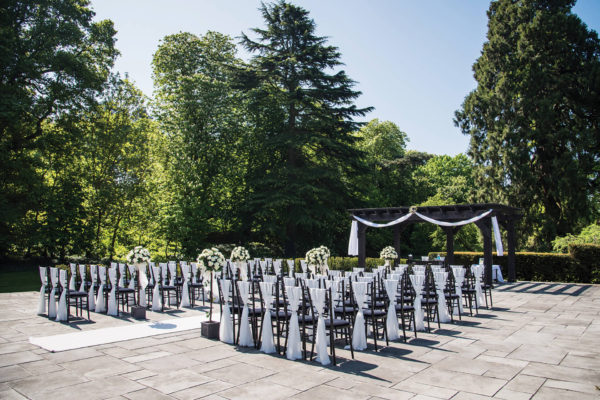 The patio at Swynford Manor is set up for an outdoor wedding ceremony