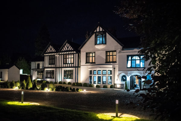 Swynford Manor wedding venue in Cambridgeshire looks stunning lit up for an evening wedding reception