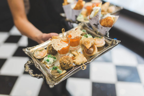 Delicious wedding canapes are served during a drinks reception at Swynford Manor