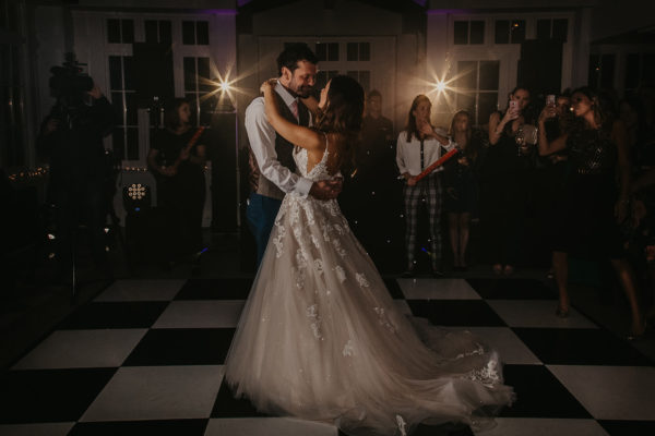 In The Garden Room at Swynford Manor a brides dress sparkles during her first dance