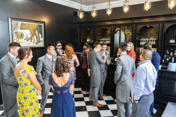 Wedding guests enjoy a wedding reception at Swynford Manor wedding venue